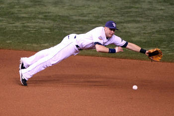 ST PETERSBURG, FL - OCTOBER 22:  Evan Longoria #3 of the Tampa Bay Rays dives for a ball but fails to make the play against the Philadelphia Phillies during game one of the 2008 MLB World Series on October 22, 2008 at Tropicana Field in St. Petersburg, Fl