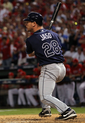 ARLINGTON, TX - OCTOBER 09:  Catcher John Jaso #28 of the Tampa Bay Rays hits a RBI single against the Texas Rangers in the 8th inning during game 3 of the ALDS at Rangers Ballpark in Arlington on October 9, 2010 in Arlington, Texas.  (Photo by Ronald Mar