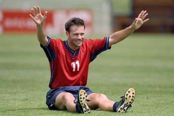 17 Jun 1998:  Eric Wynalda #11 raises his arms as he sits on the field during the USA  World Cup Training at Stade De Fetan in Trevoux, France. Mandatory Credit: Brian Bahr  /Allsport
