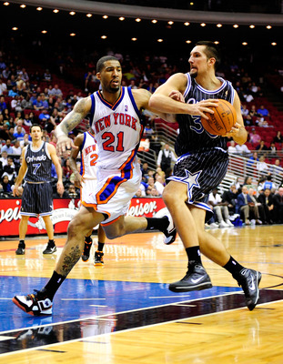 ORLANDO, FL - DECEMBER 02:  Ryan Anderson #33 of the Orlando Magic drives against Wilson Chandler #21 of the New York Knicks during the game at Amway Arena on December 2, 2009 in Orlando, Florida.  NOTE TO USER: User expressly acknowledges and agrees that