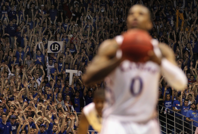 LAWRENCE, KS - JANUARY 29:  A fan holds up a sign depicting the initials of his late mother as Thomas Robinson #0 of the Kansas Jayhawks shoots a free throw during the game against the Kansas State Wildcats on January 29, 2011 at Allen Fieldhouse in Lawre