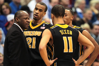LAWRENCE, KS - FEBRUARY 07:  Head coach Mike Anderson of the Missouri Tigers talks with players during the game against the Kansas Jayhawks on February 7, 2011 at Allen Fieldhouse in Lawrence, Kansas.  (Photo by Jamie Squire/Getty Images)