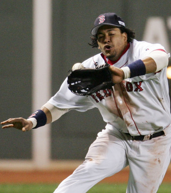 BOSTON - OCTOBER 23:  Left fielder Manny Ramirez #24 of the Boston Red Sox misplays a line-drive hit by Larry Walker #33 of the St. Louis Cardinals in the eighth inning during game one of the World Series on October 23, 2004 at Fenway Park in Boston, Mass