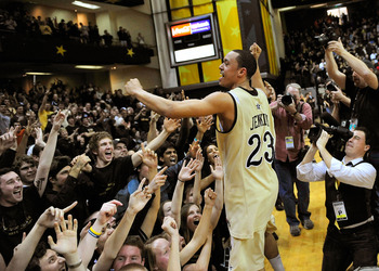 NASHVILLE, TN - FEBRUARY 12:  John Jenkins #23 of the Vanderbilt Commodores celebrates with fans after a win over the Kentucky Wildcats at Memorial Gym on February 12, 2011 in Nashville, Tennessee. Vanderbilt won 81-77.  (Photo by Grant Halverson/Getty Im