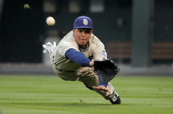 DENVER - APRIL 10:  Rightfielder Will Venable #25 of the San Diego Padres dives buts is unable to make a catch on a soft linedrive by Clint Barmes of the Colorado Rockies in the third inning during MLB action at Coors Field on April 10, 2010 in Denver, Co
