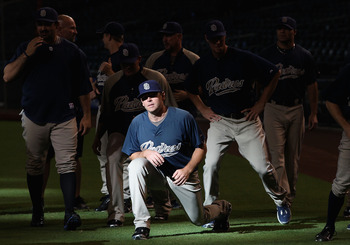 PHOENIX - AUGUST 30:  Pitcher Tim Stauffer #46 of the San Diego Padres warms up with teammates before the Major League Baseball game against the Arizona Diamondbacks at Chase Field on August 30, 2010 in Phoenix, Arizona.  (Photo by Christian Petersen/Gett