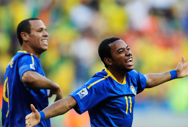 PORT ELIZABETH, SOUTH AFRICA - JULY 02:  Luis Fabiano (L) celebrates with Robinho of Brazil after he scored the opening goal during the 2010 FIFA World Cup South Africa Quarter Final match between Netherlands and Brazil at Nelson Mandela Bay Stadium on Ju