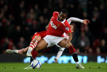 MANCHESTER, ENGLAND - FEBRUARY 19:  Oliveira Anderson of Manchester United is challenged by Dannie Bullman of Crawley Town during the FA Cup sponsored by E.ON 5th round match between Manchester United and Crawley Town at Old Trafford on February 19, 2011