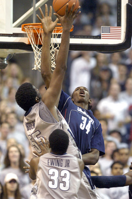 WASHINGTON - JANUARY 12:   Hasheen Thabeet #34 of the University of Connecticut blocks a shot by Roy Hibbert #55 of the Georgetown Hoyas at the Verizon Center on January 12, 2008 in Washington, D.C. (Photo by Greg Fiume/Getty Images)