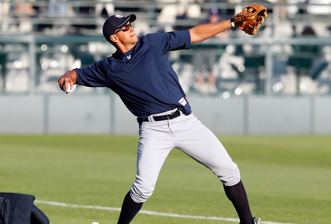 SARASOTA, FL - MARCH 07:  Infielder Alex Rodriguez #13 of the New York Yankees warms up just prior to the start of the Grapefruit League Spring Training Game against the Baltimore Orioles at Ed Smith Stadium on March 7, 2011 in Sarasota, Florida.  (Photo