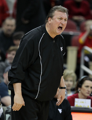 LOUISVILLE, KY - JANUARY 26: Bob Huggins the Head Coach of the West Virginia Mountaineers gives instructions to his team during the Big East Conference game against the Louisville Cardinals at the KFC Yum! Center on January 26, 2011 in Louisville, Kentuck