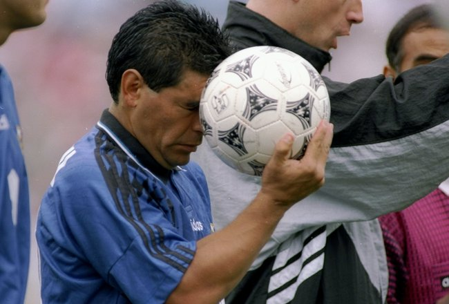 21 Jun 1994:  Diego Maradona of Argentina holds a soccer ball during a game against Greece. Mandatory Credit: Simon Bruty  /Allsport