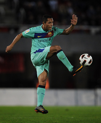 MALLORCA, SPAIN - FEBRUARY 26:  Adriano of FC Barcelona controls the ball during the La Liga match between Mallorca and Barcelona at Iberstar Stadium on February 26, 2011 in Mallorca, Spain. Barcelona won 3-0.  (Photo by David Ramos/Getty Images)