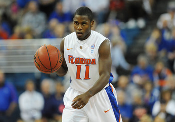 GAINESVILLE, FL - NOVEMBER 16: Guard Erving Walker #11 of the Florida Gators plays against the Ohio State Buckeyes November 16, 2010 at the Stephen C. O'Connell Center in Gainesville, Florida.  (Photo by Al Messerschmidt/Getty Images)