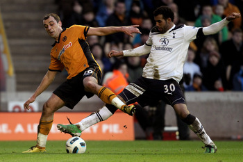 WOLVERHAMPTON, ENGLAND - MARCH 06:  Nenad Milijas (L) of Wolves is challenged by Sandro of Tottenham during the Barclays Premier League match between Wolverhampton Wanderers and Tottenham Hotspur at Molineux on March 6, 2011 in Wolverhampton, England.  (P