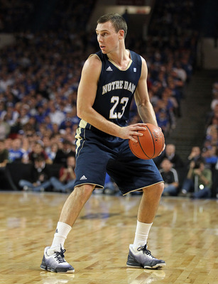 LOUISVILLE, KY - DECEMBER 08:  Ben Hansbrough #23 of the Notre Dame Fighting Irish dribbles the ball during the game against the Kentucky Wildcats in the 2010 DIRECTV SEC/BIG EAST Invitational at Freedom Hall on December 8, 2010 in Louisville, Kentucky.