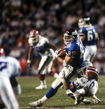 TAMPA, FL - JANUARY 27:  Tight end Mark Bavaro #89 of the New York Giants fights for yardage against safety Mark Kelso #38 of the Buffalo Bills during Super Bowl XXV at Tampa Stadium on January 27, 1991 in Tampa, Florida. The Giants defeated the Bills 20-