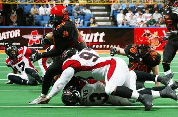 UNIONDALE, NY - APRIL 26:  Ricky Hall #49 of the New York Dragons runs the ball against the Cleveland Gladiators on April 26, 2008 at Nassau Coliseum in Uniondale, New York.  Dragons defeat Gladiators 56-39.  (Photo by Mike Stobe/Getty Images for the New