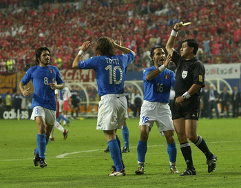 DAEJEON - JUNE 18:  Francesco Totti of Italy is shown his second yellow card for diving by referee Byron Moreno of Ecuador during the FIFA World Cup Finals 2002 Second Round match between South Korea and Italy played at the Daejeon World Cup Stadium, in D