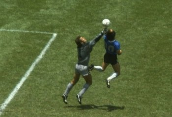 22 Jun 1986:  Diego Maradona of Argentina handles the ball past Peter Shilton of England to score the opening goal of the World Cup Quarter Final at the Azteca Stadium in Mexico City, Mexico. Argentina won 2-1. \ Mandatory Credit: Allsport UK /Allsport