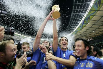 BERLIN - JULY 09:  Italian players celebrate with the world cup trophy after their team's victory during the FIFA World Cup Germany 2006 Final match between Italy and France at the Olympic Stadium on July 9, 2006 in Berlin, Germany.  (Photo by Michael Ste