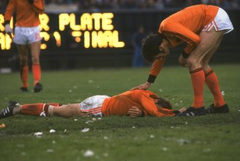 25 Jun 1978:  A Dutch player lies distraught whilst his team mate tries to console him after the World Cup final between Holland and Argentina at the Monumental in Buenos Aires, Argentina. Argentina won the match  3-1. \ Mandatory Credit: Allsport UK /All