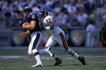 9 Sep 2001:  Warrick Holdman #53 of the Chicago Bears tries to strip the ball and tackle Brandon Stokely #80 during the game against the Baltimore Ravens at PSNIET Stadium in Baltimore, Maryland. The Ravens defeated the Bears 17-6.Mandatory Credit: Doug P