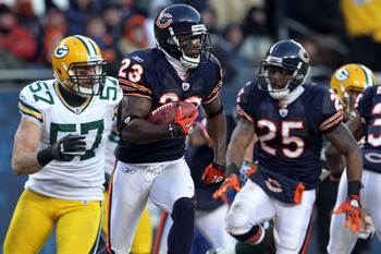 CHICAGO, IL - JANUARY 23:  Devin Hester #23 of the Chicago Bears returns a kick against the Green Bay Packers in the NFC Championship Game at Soldier Field on January 23, 2011 in Chicago, Illinois.  (Photo by Jamie Squire/Getty Images)