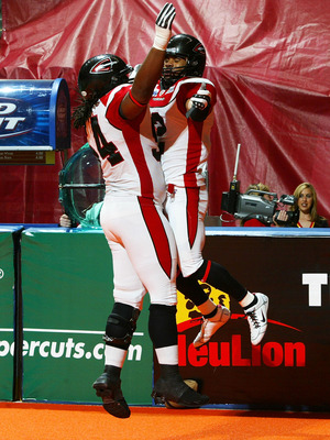 UNIONDALE, NY - APRIL 26:  Robert Redd #2 of the Cleveland Gladiators celebrates his first half touchdown with teammate Brandon Hefflin #24 against the New York Dragons on April 26, 2008 at Nassau Coliseum in Uniondale, New York.  Dragons defeat Gladiator