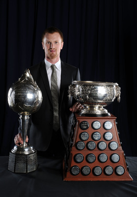 LAS VEGAS - JUNE 23:  Henrik Sedin of the Vancouver Canucks poses for a portrait with the Hart Memorial Trophy and the Art Ross Trophy during the 2010 NHL Awards at the Palms Casino Resort on June 23, 2010 in Las Vegas, Nevada.  (Photo by Harry How/Getty
