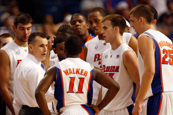 TAMPA, FL - MARCH 12:  Head coach Billy Donovan of the Florida Gators talks with his team during a time out against the Arkansas Razorbacks during the first round of the SEC Men's Basketball Tournament at the St. Pete Times Forum March 12, 2009 in Tampa,