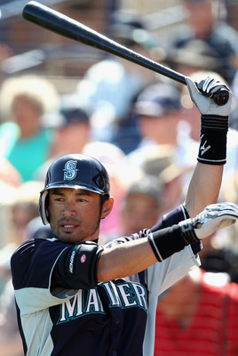 PEORIA, AZ - MARCH 04:  Ichiro Suzuki #51 of the Seattle Mariners warms up on deck during the spring training game against the Cincinnati Reds at Peoria Stadium on March 4, 2011 in Peoria, Arizona.  (Photo by Christian Petersen/Getty Images)