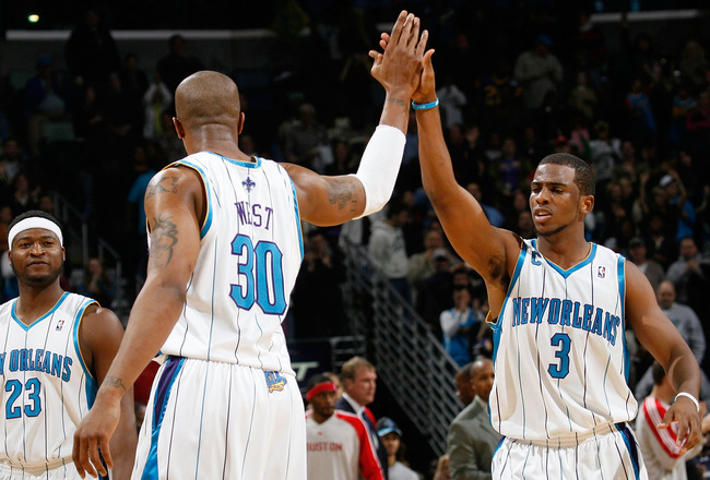 NEW ORLEANS, LA - JANUARY 02:  David West #30 and Chris Paul #3 of the New Orleans Hornets celebrate during the game against the Houston Rockets at the New Orleans Arena on January 2, 2010 in New Orleans, Louisiana.  NOTE TO USER: User expressly acknowled