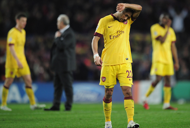 BARCELONA, SPAIN - MARCH 08:  Gael Clichy of Arsenal leaves the field at the end of the UEFA Champions League round of 16 second leg match between Barcelona and Arsenal at the Nou Camp Stadium on March 8, 2011 in Barcelona, Spain.  (Photo by Shaun Botteri