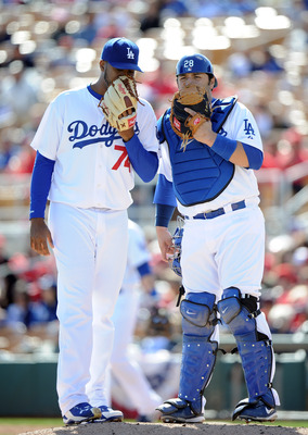 PHOENIX, AZ - FEBRUARY 27:  Kenley Jansen #74 and Rod Barajas #28 of the Los Angeles Dodgers meet on the mound during spring training at Camelback Ranch on February 27, 2011 in Phoenix, Arizona.  (Photo by Harry How/Getty Images)