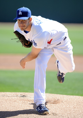 PHOENIX, AZ - FEBRUARY 28:  Clayton Kershaw #22 of the Los Angeles Dodgers pitches against the Chicago White Sox during spring training at Camelback Ranch on February 28, 2011 in Phoenix, Arizona.  (Photo by Harry How/Getty Images)