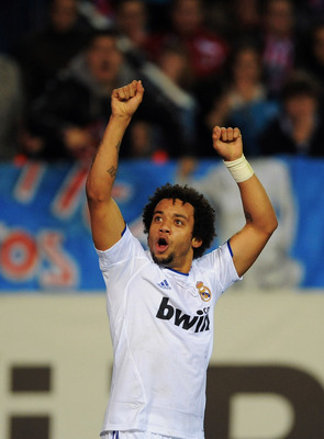 MADRID, SPAIN - JANUARY 20:  Marcelo of Real Madrid celebrates after Real  scored their first goal during the Copa del Rey quarter final second leg match between Atletico Madrid and Real Madrid at Vicente Calderon Stadium on January 20, 2011 in Madrid, Sp