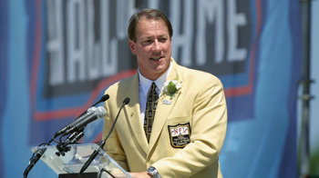 CANTON, OHIO - AUGUST 3:  Jim Kelly speaks at the  podium during his induction into the National Football League Hall of Fame on August 3, 2002 at Fawcett Stadium in Canton, Ohio.  Kelly played quarterback for the Buffalo Bills from 1986 to 1996 and led t