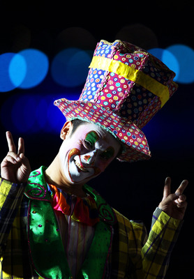 GUANGZHOU, CHINA - NOVEMBER 12:  A performer dressed as a clown smiles during the Opening Ceremony for the 16th Asian Games Guangzhou 2010 at Haixinsha Square on November 12, 2010 in Guangzhou, China.  (Photo by Hannah Johnston/Getty Images)