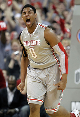 COLUMBUS, OH - MARCH 06: Jared Sullinger #0 of the Ohio State Buckeyes reacts after a first half dunk while playing the Wisconsin Badgers on March 6, 2011 at the Value City Arena in Columbus, Ohio.  (Photo by Gregory Shamus/Getty Images)