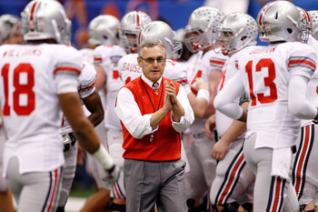 NEW ORLEANS, LA - JANUARY 04:  Head coach Jim Tressel of the Ohio State Buckeyes gathers his team before the Allstate Sugar Bowl against the Arkansas Razorbacks at the Louisiana Superdome on January 4, 2011 in New Orleans, Louisiana.  (Photo by Chris Gray