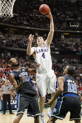 ANAHEIM, CA - MARCH 27:  Nick Collison #4 of Kansas shoots over the defense of Casey Sanders #20 and Sean Dockery #15 of Duke during the NCAA Tournament at the Arrowhead Pond on March 27, 2003 in Anaheim, California.  Kansas defeated Duke 69-65.  (Photo b