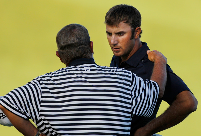 KOHLER, WI - AUGUST 15:  A PGA of America rules official chats with Dustin Johnson (R) on the 18th green during the final round of the 92nd PGA Championship on the Straits Course at Whistling Straits on August 15, 2010 in Kohler, Wisconsin.  (Photo by Sam