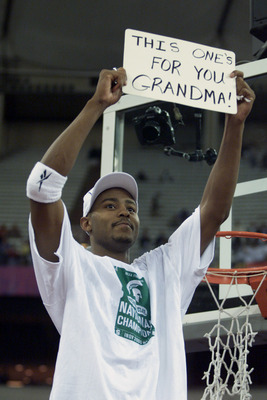 3 Apr 2000: Morris Peterson #42 of Michigan State holds up a sign dedicating their win to his recently deceased grandmother while cutting down his peace of the net after defeating Florida 89-76 to win the final round of the NCAA Men''s Final Four at the R