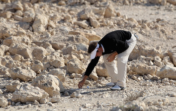 DOHA, QATAR - FEBRUARY 04:  Pablo Martin of Spain on the rocks on the par five 9th hole during the second round of the Commercialbank Qatar Masters at the Doha Golf Club on February 4, 2011 in Doha, Qatar.  (Photo by Ross Kinnaird/Getty Images)