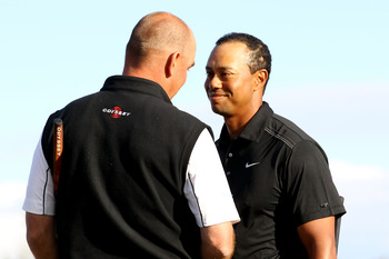 MARANA, AZ - FEBRUARY 23:  Tiger Woods (R) congratulates Thomas Bjorn of Denmark (L) on his win on the 19th hole during the first round of the Accenture Match Play Championship at the Ritz-Carlton Golf Club on February 23, 2011 in Marana, Arizona.  (Photo