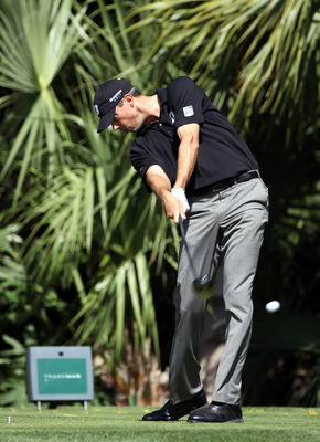 PALM BEACH GARDENS, FL - MARCH 04:  Matt Kuchar plays a shot on the 3rd hole during the second round of The Honda Classic at PGA National Resort and Spa on March 4, 2011 in Palm Beach Gardens, Florida.  (Photo by Sam Greenwood/Getty Images)