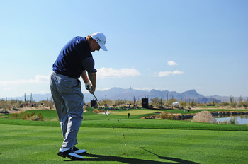 MARANA, AZ - FEBRUARY 24:  Ernie Els of South Africa plays his tee shot on the fifth hole during the second round of the Accenture Match Play Championship at the Ritz-Carlton Golf Club on February 24, 2011 in Marana, Arizona.  (Photo by Stuart Franklin/Ge