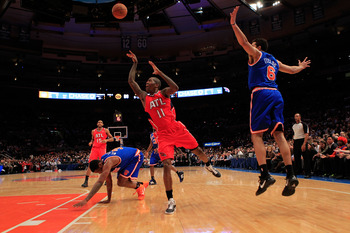NEW YORK, NY - FEBRUARY 16:  Jamal Crawford #11 of the Atlanta Hawks shoots past Landry Fields #6 of the New York Knicks at Madison Square Garden on February 16, 2011 in New York City. NOTE TO USER: User expressly acknowledges and agrees that, by download