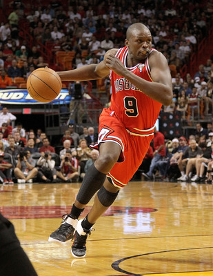 MIAMI, FL - MARCH 06:  Luol Deng #9 of  the Chicago Bulls drives into the lane during a game against the Miami Heat at American Airlines Arena on March 6, 2011 in Miami, Florida. NOTE TO USER: User expressly acknowledges and agrees that, by downloading an